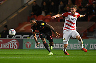 Jerome Sinclair of Sunderland (17) breaks past Joe Wright of Doncaster Rovers (5) during the EFL Sky Bet League 1 match between Doncaster Rovers and Sunderland at the Keepmoat Stadium, Doncaster, England on 23 October 2018.