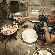Devo Baghel (48) at home, preparing Gup-chup, a savory street food snack, that she sells every night on the streets of Raipur. She  took a Rs 5,000 (EUR 72)  loan through the microfinancing program to broaden her small scale business, selling Gup-chup and other savories. Her weekly payment for the loan is Rs 224 (EUR 3.2).
