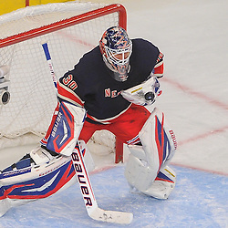 New York Rangers goalie Henrik Lundqvist (30) makes a save with the back of his catching glove during first period NHL action between the New York Rangers and the Boston Bruins at Madison Square Garden in New York, N.Y.