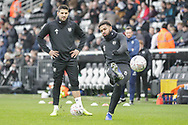 Fulham defender Cyrus Christie (22) warming up before The FA Cup 3rd round match between Fulham and Oldham Athletic at Craven Cottage, London, England on 6 January 2019.