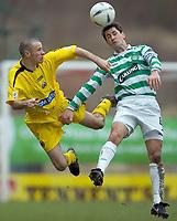 Clyde v Celtic, ScottishCup  quarter final, Broadwood Stadium, Cumbernauld. Sunday 27/02/2005<br /> Jackie Macnamara heads clear from Eddie Malone