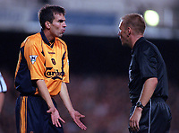 Liverpool defender Markus Babbel questions a typically bad decision by referee Graham Poll. Arsenal 2:0 Liverpool, F.A.Carling Premiership, 21/8/2000. Credit : Colorsport / Andrew Cowie.