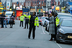 © Licensed to London News Pictures. 30/10/2020. London, UK. Police officers and detectives at a crime scene on West Green Road in Tottenham, north London, following the stabbing of a man in his 20s. Photo credit: Dinendra Haria/LNP