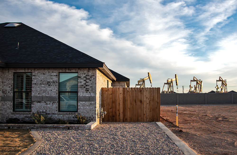 Pump jacks in the middle of Pavilion Park a  <br /> D.R Horton America Builder development in Midland Texas