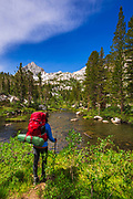 Backpacker on the Treasure Lakes trail at Bishop Creek, John Muir Wilderness, Sierra Nevada Mountains, California USA