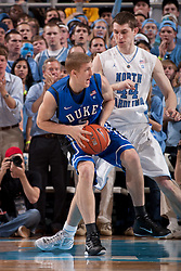 CHAPEL HILL, NC - MARCH 05: Mason Plumlee #5 of the Duke Blue Devils dribbles around Tyler Zeller #44 of the North Carolina Tar Heels on March 05, 2011 at the Dean E. Smith Center in Chapel Hill, North Carolina. North Carolina won 67-81. (Photo by Peyton Williams/UNC/Getty Images) *** Local Caption *** Mason Plumlee;Tyler Zeller