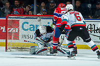 KELOWNA, BC - JANUARY 31: Leif Mattson #28 of the Spokane Chiefs looks for the puck as Cole Schwebius #31 makes a save and Kaedan Korczak #6 of the Kelowna Rockets defends his position at Prospera Place on January 31, 2020 in Kelowna, Canada. (Photo by Marissa Baecker/Shoot the Breeze)