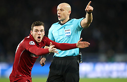 Liverpool's Andrew Robertson reacts after Referee Szymon Marciniak's initial decision to give a corner rather than a penalty
