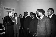 """06/05/1965<br /> 05/06/1965<br /> 06 May 1965<br /> African Students on a visit to Dublin. A group of African students of Catholic Sociology from Claver House, London, on an educational holiday to Ireland. The group stayed with Irish families under the auspices of """"Le Cheile"""" a group that promoted friendship and exchange of culture between Irish and overseas people. the students were entertained by His Grace, Most Rev. Dr. McQuaid, Archbishop of Dublin to a visit to the Dublin Institute of Catholic Sociology. Photo Shows Archbishop McQuaid chatting to the students."""