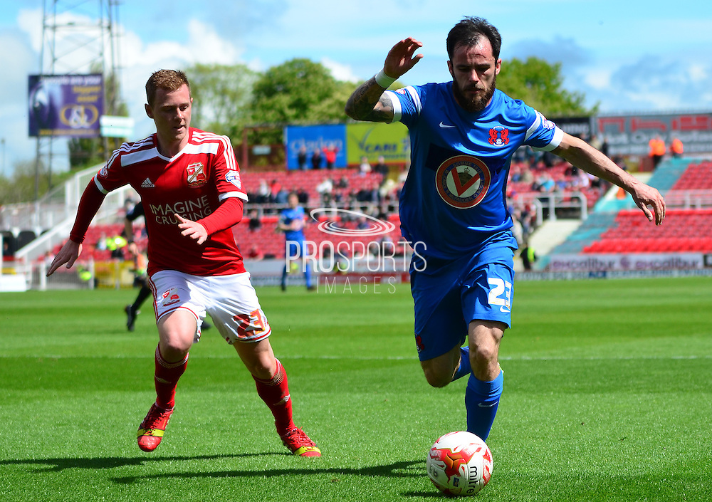 Chris Dagnell being tracked by Jack Barthram during the Sky Bet League 1 match between Swindon Town and Leyton Orient at the County Ground, Swindon, England on 3 May 2015. Photo by Alan Franklin.