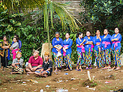 13 JULY 2016 - UBUD, BALI, INDONESIA: Balinese women at the mass cremation. Local people in Ubud exhumed the remains of family members and burned their remains in a mass cremation ceremony Wednesday. Almost 100 people will be cremated and laid to rest in the largest mass cremation in Bali in years this week. Most of the people on Bali are Hindus. Traditional cremations in Bali are very expensive, so communities usually hold one mass cremation approximately every five years. The cremation in Ubud will conclude Saturday, with a large community ceremony.      PHOTO BY JACK KURTZ