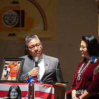 Navajo Nation Vice-President Myron Lizer and Second Lady Dottie Lizer present a framed proclamation and the Navajo Nation flag to the family of Navajo Code Talker Joe Vandever Sr. at his funeral service at El Morro Theatre Wednesday in Gallup. The proclamation was issued Monday, Feb. 3 by the Navajo Nation President Jonathan Nez and Vice President Myron Lizer that called for flags on the Navajo Nation to be flown at half-staff from Feb. 3 through Feb. 6, in honor and memory of Vandever.