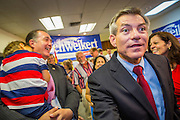 28 AUGUST 2012 - PHOENIX, AZ:  Rep. DAVID SCHWEIKERT (R-AZ), right, greets people arriving at his campaign office for his victory party in Phoenix Tuesday night. Schweikert faced Congressman Ben Quayle in what was the hardest Republican primary election in Arizona in 2012. Both were incumbent Republican freshmen elected to Congress from neighboring districts in 2010. They ended up in the same district at the end of the redistricting process and faced off against each other in the primary to represent Arizona's 6th Congressional District, which is made up of Scottsdale, Paradise Valley and parts of Phoenix. The district is solidly Republican and the winner of the primary is widely expected to win November's general election. Both are conservative Republicans with Tea Party backing.   PHOTO BY JACK KURTZ