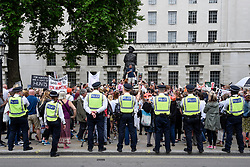 "© Licensed to London News Pictures. 29/05/2017. London UK. Visible police security is present as demonstrators stage an ""Anti-Hunting March"" in central London, marching from Cavendish Square to outside Downing Street.  Protesters are demanding that the ban on fox hunting remains, contrary to reported comments by Theresa May, Prime Minister, that the 2004 Hunting Act could be repealed after the General Election.<br />  Photo credit : Stephen Chung/LNP"