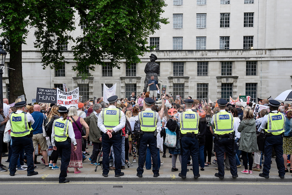 """© Licensed to London News Pictures. 29/05/2017. London UK. Visible police security is present as demonstrators stage an """"Anti-Hunting March"""" in central London, marching from Cavendish Square to outside Downing Street.  Protesters are demanding that the ban on fox hunting remains, contrary to reported comments by Theresa May, Prime Minister, that the 2004 Hunting Act could be repealed after the General Election.<br />  Photo credit : Stephen Chung/LNP"""
