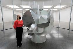 """© Licensed to London News Pictures. 07/07/2021. LONDON, UK. A staff member views """"Vanguard"""", 2021, by Liu Wei. Preview of 'Nudità', the biggest exhibition in the UK to date by Beijing-based artist Liu Wei.  New large-scale installations, sculptures and paintings made in response to the global pandemic are on display at White Cube, Bermondsey, 9 July to 5 September 2021.  Photo credit: Stephen Chung/LNP"""