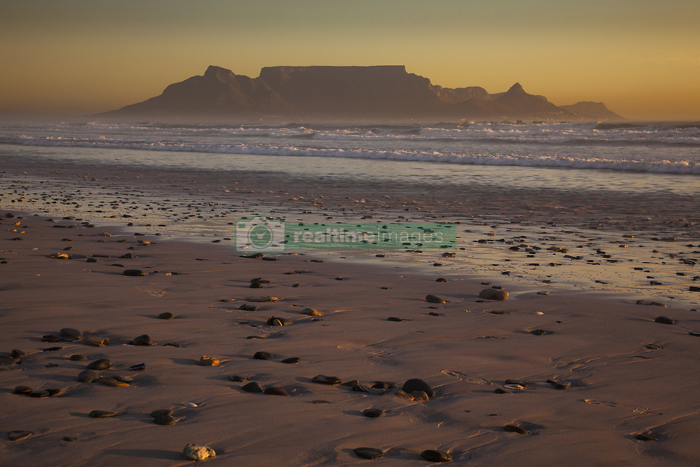 Feb. 3, 2014 - Table Mountain and the outline of Devil's Peak and Lion's Head, viewed from the shores of Blouberg beach in Western Cape. (Credit Image: © Art Wolfe/Mint Images/ZUMA Wire)