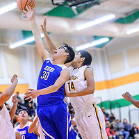 Zuni Thunderbird Landers Shelendewa  (30), center and Tohatchi Cougar Austin Haley (14) reach for a rebound  during the Wingate Holiday Classic basket ball tournament at Wingate High School Thursday.