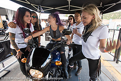 Iron Lilies Sarah Furey, Kissa Von Addams, Samantha Campana and Leticia Cline joke with Megan Ecker and Harley-Davidson's Maria Catalano after Megan learned how to shift gears in the Harley-Davidson Jumpstart area during the annual Sturgis Black Hills Motorcycle Rally.  SD, USA.  August 12, 2016.  Photography ©2016 Michael Lichter.