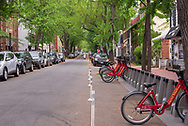 Washington, DC, USA --  May 6, 2018. Photo of  a quiet tree-lined neighborhood street in the Georgetown section of Washington, DC.