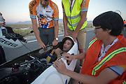 Sebastiaan Bowier komt uitgeput aan op de laatste racedag van de WHPSC. In de buurt van Battle Mountain, Nevada, strijden van 10 tot en met 15 september 2012 verschillende teams om het wereldrecord fietsen tijdens de World Human Powered Speed Challenge. Het huidige record is 133 km/h.<br /> <br /> Sebastiaan Bowier finishes the last race on the sixth day of the WHPSC. Near Battle Mountain, Nevada, several teams are trying to set a new world record cycling at the World Human Powered Vehicle Speed Challenge from Sept. 10th till Sept. 15th. The current record is 133 km/h.