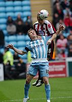 Photo: Kevin Poolman.<br />Coventry City v Sheffield United. Coca Cola Championship. 11/03/2006. Sheffield Utd's Derek Geary climbs over Coventry's Gary McSheffrey.