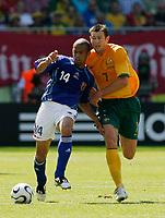 Photo: Glyn Thomas.<br />Australia v Japan. Group F, FIFA World Cup 2006. 12/06/2006.<br /> Australia's Brett Emerton (R) and Japan's Alessandro Santos.