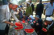 Watermelon stall in Kashgar market, far western China, Central Asia.