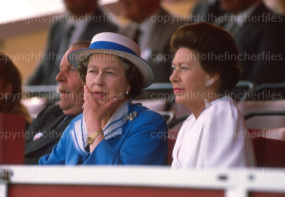 Her Majesty Queen Elizabeth seen with her sister Princess Margaret at the Royal Windsor horse Show, Windsor,UK in May 1988. Photographed by Jayne Fincher