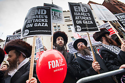 """London, July 5th 2014. Jews from the Naturei Karta demonstrate with hundreds protesting near the Israeli embassy in London against the ongoing occupation of Palestine and the west's support of """"Israel's collective punishment of Palestinians""""."""