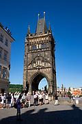 Tall tower entrance to the Charles bridge that spans the Vltava River in Prague, Czech Republic