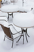 Vertical of cafe tables and chairs with snow