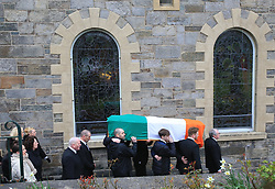 © Licensed to London News Pictures. 23/03/2017. Londonderry, UK. The coffin of Martin McGuinness is acarried into St Columba's Church in Londonderry, Northern Ireland 23 March, 2017 during the funeral of Sinn Féin's Martin McGuinness. Mr McGuinness, a former IRA leader turned politician, died on Tuesday.. Photo credit: LNP