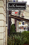 The sign to a trendy restaurant on the Quai des Chartrons called Le K. Baroque , Bordeaux, Aquitaine, France