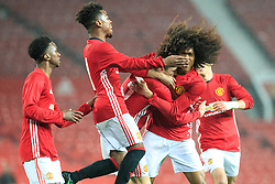 © Licensed to London News Pictures . 12/12/2016 . Manchester , UK . Celebrating substitute TAHITH CHONG (r with big hair) putting MUFC 1 - 0 up . Manchester United vs Southampton FA Youth Cup Third Round match at Old Trafford . Photo credit : Joel Goodman/LNP
