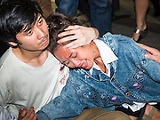 22 MAY 2015 - BANGKOK, THAILAND:  Anti-coup protestors comfort each other after police swept through the crowd and arrested several of their friends. The Thai military seized power in a coup on May 22, 2014. There were small protests throughout Bangkok Friday to mark the first anniversary of the coup. Police arrested protestors at several locations. The most serious protest was at Bangkok Art and Culture Centre (BACC) where about 100 protestors, mostly students, faced off against police for several hours. Police made numerous arrests at the BACC protest.    PHOTO BY JACK KURTZ