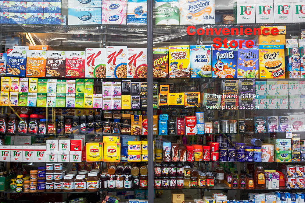 Window display detail of the products being sold in a Kensington convenience store, on 31st August 2017, in London England.