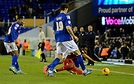 Gareth McCleary is fouled during the Sky Bet Championship match between Birmingham City and Reading at St Andrews, Birmingham, England on 13 December 2014.