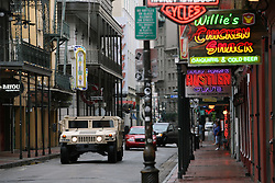 28 August 2012. New Orleans, Louisiana,  USA. <br /> The Louisiana National Guard patrols an almost deserted Bourbon Street in the French Quarter. The Guard is in place ahead of Hurricane Isaac to provide enhanced security patrols. The 7th year anniversary of Hurricane Katrina is tomorrow and with a storm lurking in the Gulf many have evacuated as an uneasy calm settles over New Orleans.<br /> Photo; Charlie Varley