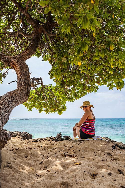 A portrait of a smiling middle aged woman on Mahai'ula beach, Kona, Hawaii, USA.