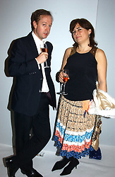 GEORDIE GRIEG and ALEXANDRA SHULMAN at the Moet & Chandon Fashion Tribute 2005 to Matthew Williamson, held at Old Billingsgate, City of London on 16th February 2005.<br />