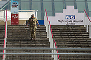 Army personnel outside NHS Nightingale a 4,000 bed field hospital in Londons Excel Centre in the battle against coronavirus. NHS Nightingale has been erected with help of the military  in London's Docklands, will initially contain 500 beds with ventilators and oxygen to treat seriously ill patients and ultimately has capacity for 4,000 patients across two wards.