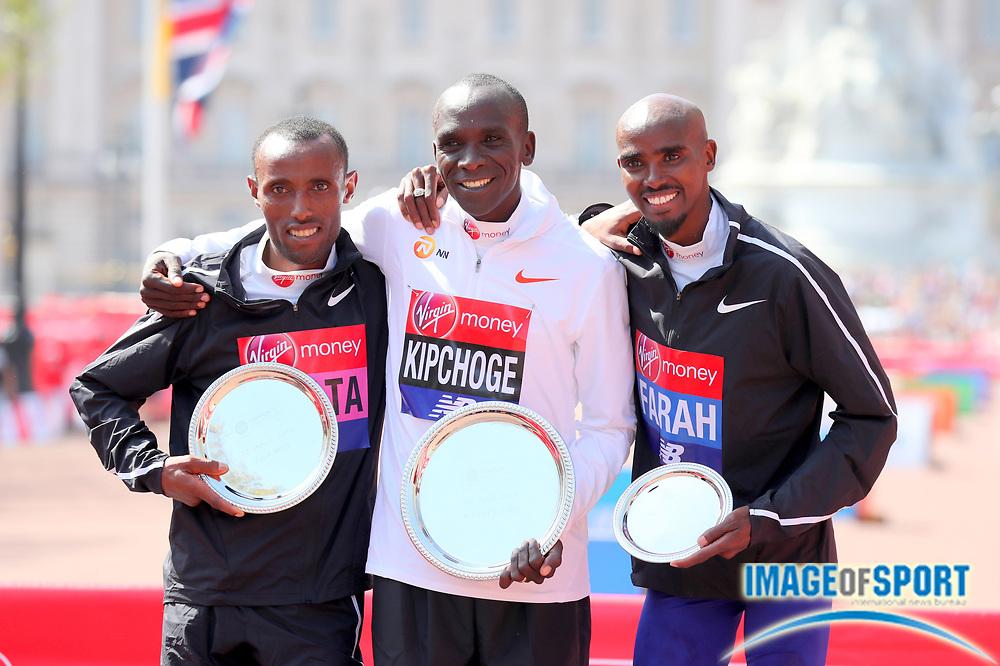 London Marathon marathon winner Eliud Kipchoge (KEN), center, poses with runner-up Tola Kitata (ETH) and Mo Farah aka Mohamed Farah  in London, Sunday, April 22, 2018. (Jiro Mochizuki/Image of Sport)