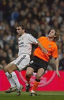 15/2/2004 Madrid, Spain.<br />La Liga (Spanish League), stage 24.<br />R.Madrid 1 - Valencia 1<br />R.Madrid's Raul Bravo in duel with Valencia's Mista at Santiago Bernabeu's Stadium.<br />© 2004 Alejandro leon Fernandez