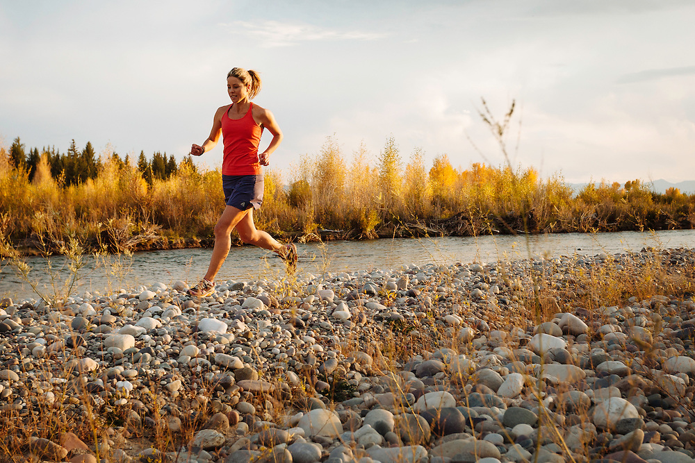Lynsey Dyer goes for an evening trail run in September along the Snake River outside Jackson Hole, Wyoming.