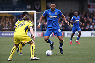 AFC Wimbledon midfielder Liam Trotter (14) taking on 2 Oxford United players during the EFL Sky Bet League 1 match between AFC Wimbledon and Oxford United at the Cherry Red Records Stadium, Kingston, England on 10 March 2018. Picture by Matthew Redman.