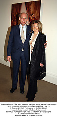 The HON.CHARLES & MRS HAMBRO, he is the son of banker Lord Hambro at an exhibition in London on 9th February 2004.PRM 215