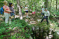Warwick, New York - Naturalist and interpretive guide Gary Keeton talks to hikers at an old lime kiln during a hike at Fuller Mountain Preserve as part of the 2012 Hudson River Valley Ramble on Sept. 15, 2012. The preserve is owned and managed by the Orange County Land Trust.