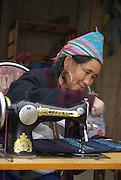 Vietnam, Sapa Market, Black Hmong woman in traditional dress