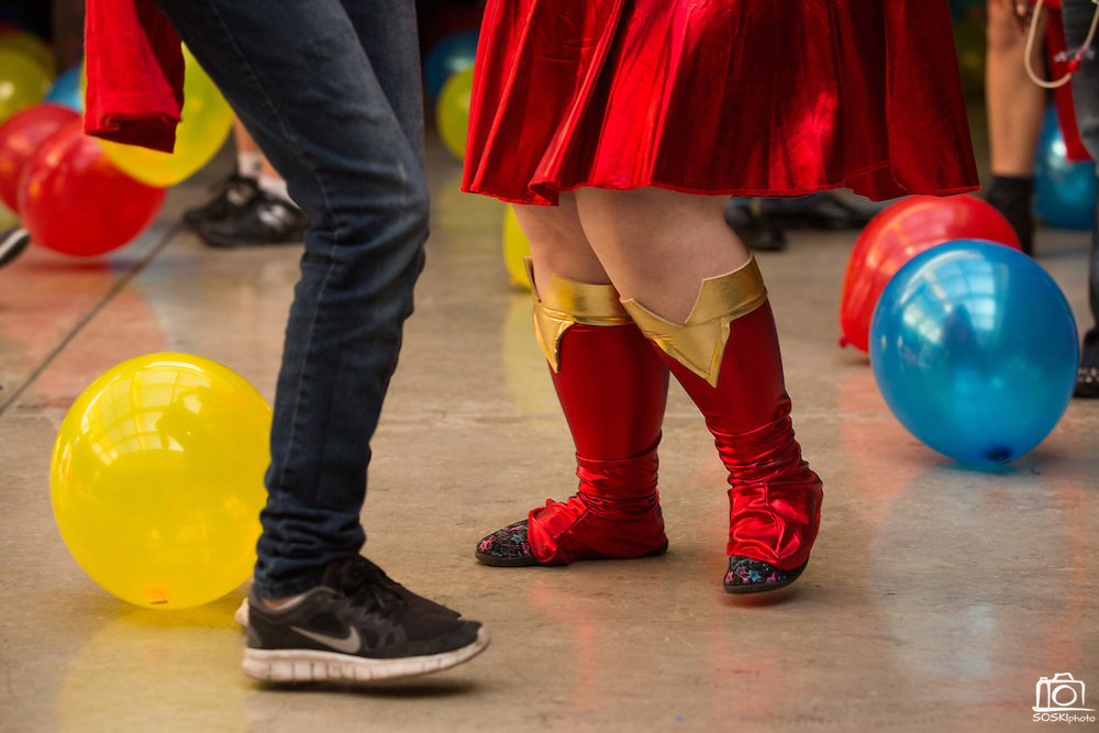 Madison Holmes, 17, right, dances in her Superman costume during the Super Hero Dance at Milpitas High School in Milpitas, California, on April 18, 2014. (Stan Olszewski/SOSKIphoto)